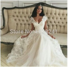 Buy Saudi Arabia Vestido De Noiva 2016 bridal gown Tulle Sexy V Neck Short Cap Sleeves Long Lace A-Line Wedding Dresses Hot Sale for $151.70 in AliExpress store