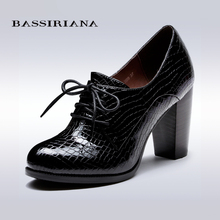 BASSIRIANA - fashion genuine patent leather ankle boots,round toe, square heel, full grain leather, free shipping(China (Mainland))