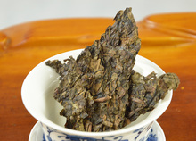 Wholesale 2002 250g Yunnan Menghai Millennium Old Tree Pu Er Gold Pornographic Films Tea Raw Brewing