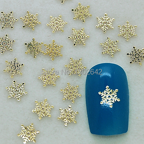 K121 200pcs/lot Fashion Snowflake Metal Nail Art Tiny Slice Case Nail Accessories For Ladies DIY Metal Stud Nail Decoration(China (Mainland))