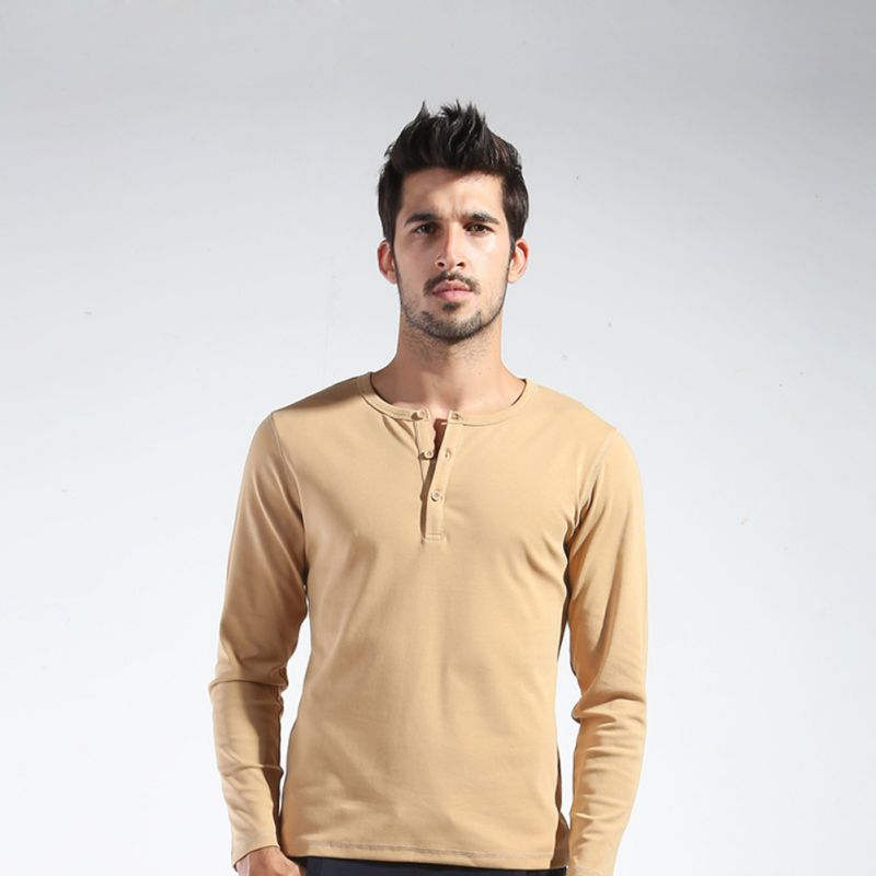 Men's Henley shirts combine fitted elegance and casual style. These pullovers are typically staples in your wardrobe. This collarless style often has anywhere from three to five buttons descending from a rounded neck. A reinforced placket holds the buttons. Types of men's Henley shirts.