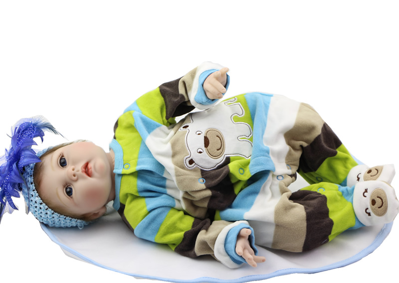 Здесь можно купить  22 Inch NPK Doll Silicone Reborn Baby Doll Can Lying And Sitting Soft Cloth Body Doll Wearing Colorful Stripe Clothing   Игрушки и Хобби