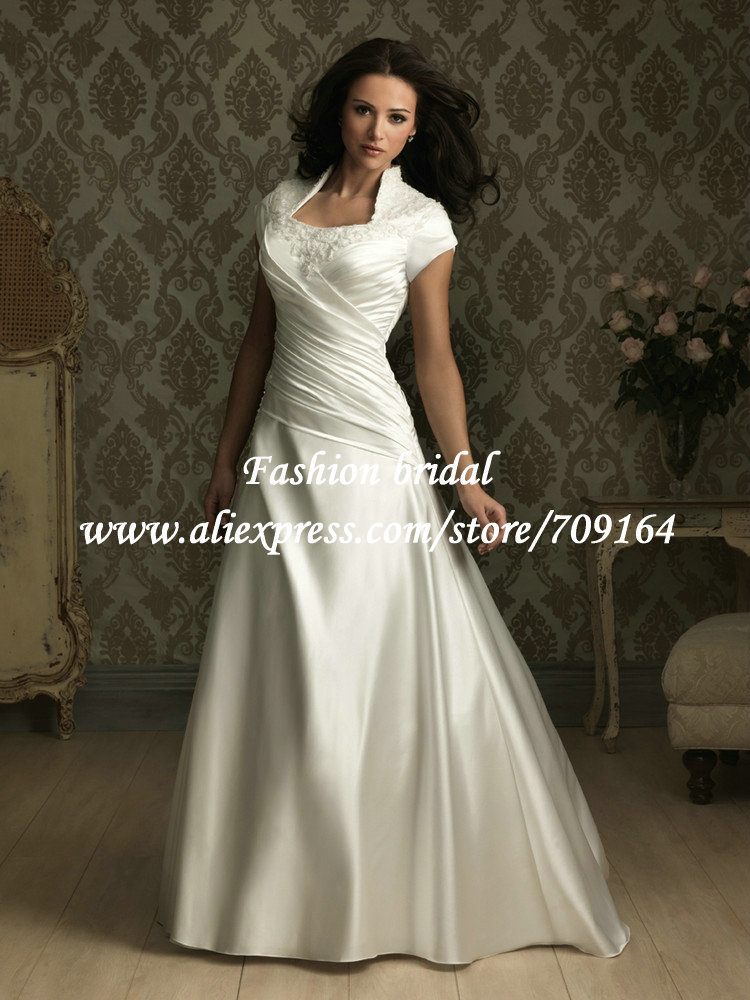 Designer a line vintage wedding dress with sleeves high for Vintage wedding dress designers