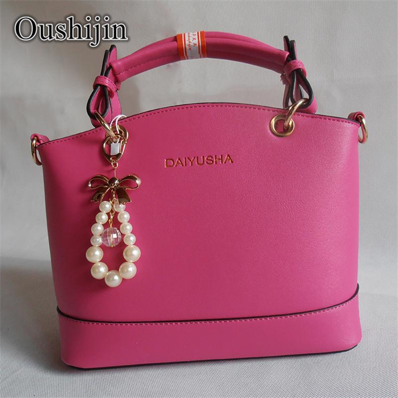 Free shipping 2015 New fashion handbag Fashion pearl pendant handbag shoulder bag lady sac a main bolsas feminina(China (Mainland))