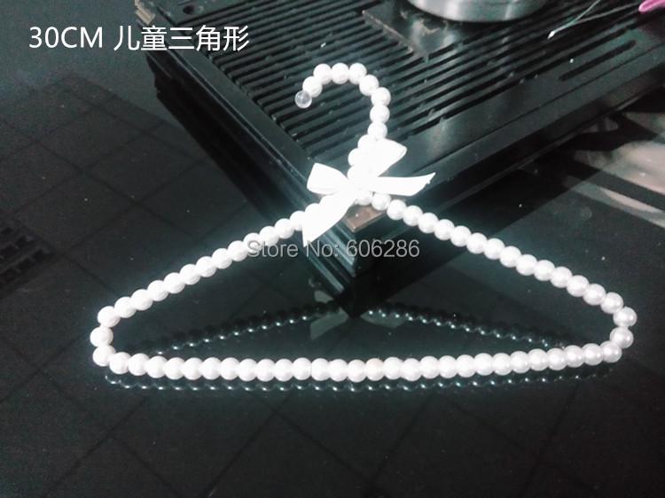 Blanc en plastique cintres promotion achetez des blanc en plastique cintres promotionnels sur - Cintre vetement bebe ...