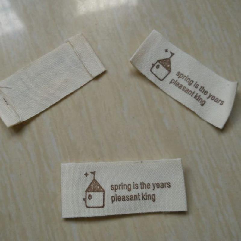 100 pcs/lot Cotton beige cloth woven label retro soft prints house logo 50 mm * 20 mm(China (Mainland))
