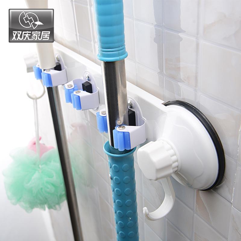Hot New home newest powerful vacuum suction cups mop shelf umbrella holder mop clip kitchen broom rack universal hanger(China (Mainland))