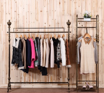 Show, wrought iron clothes hangers to hang clothes shelves fall to the ground plane <br>