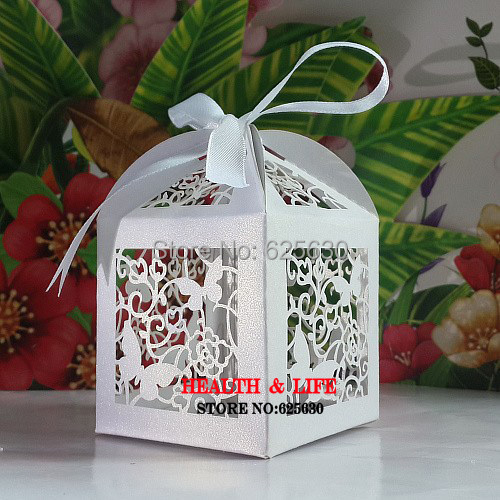 Free shipping 120pcs/lot Laser Cut Butterfly wedding candy box in pearlescent white paper candy box,birthday gift(with ribbon)(China (Mainland))