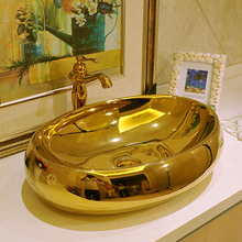 600mm Oval Gold Color Ceramic Washbowl Basin Personalized Counter Top Sink Art Washing Basin(China (Mainland))