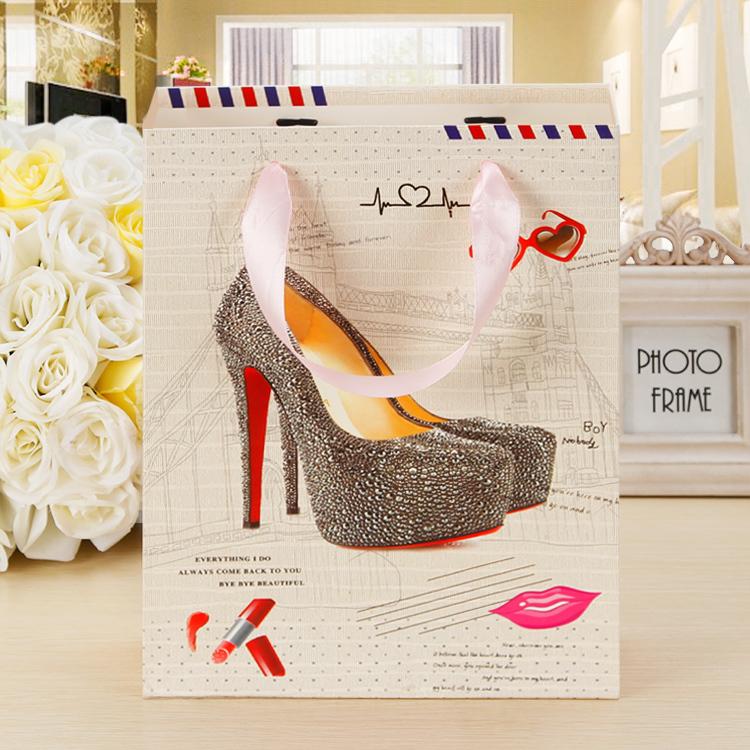 12 pieces 18*8*25 cm Environment packing material handbag shaped shoes printed gift paper package bag free shipping(China (Mainland))