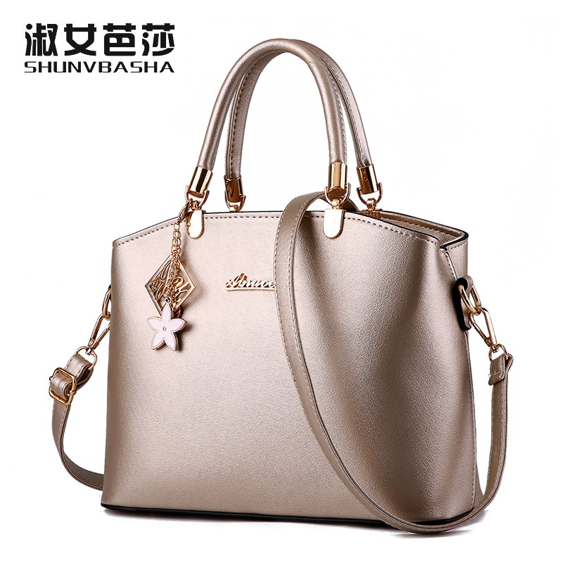 SNBS 100% Genuine leather Women handbags 2017 New wave of female messenger bag shoulder bag upscale temperament(China (Mainland))