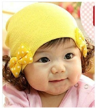 Autumn and winter child bow wig pullover knitted hat infant cap baby ear protector elastic warm hat