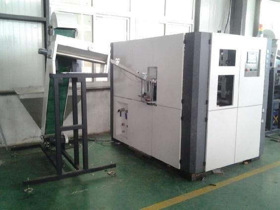 Automatic PET Bottle Blowing Machine/ blow molding machine 2 cavities/chambers with elevator/bottle blower machine video(China (Mainland))
