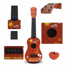 Children's toys Guitar Strings Type Kids Guitar Musical Instruments Early Education Ukulele Toys 21 Inch baby toy(China (Mainland))