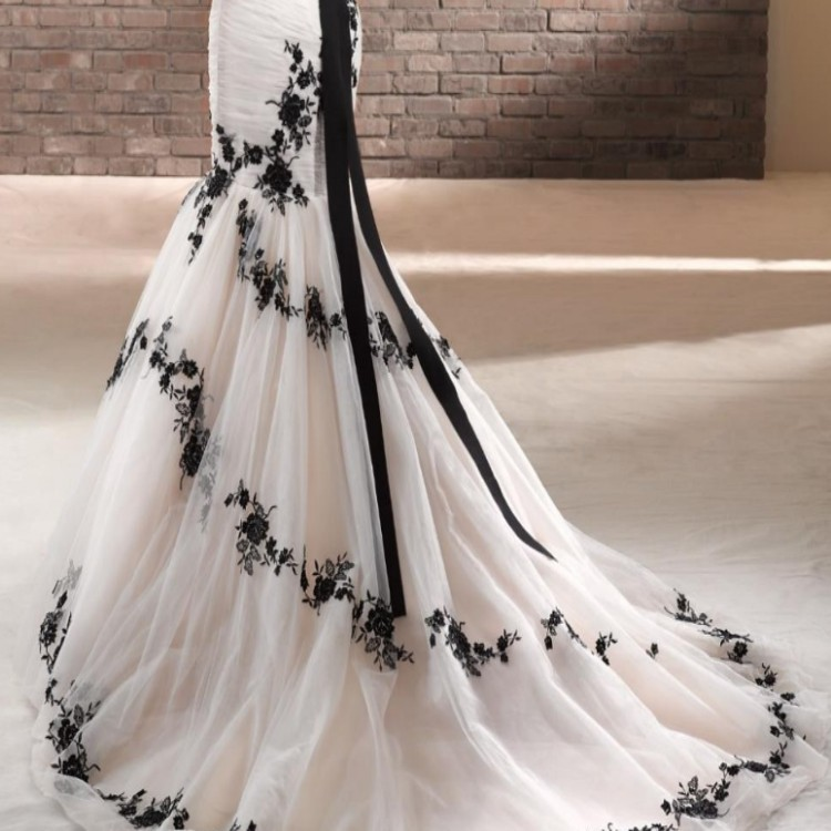 Our stunning bt14 14 from the 2014 beautiful by enzoani for Black and white plus size wedding dresses