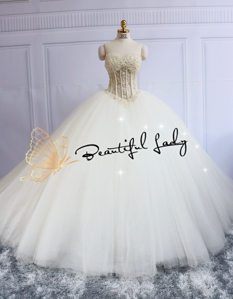 Amazing pearls stone ball gown wedding dresses 2016 real for Wedding dresses less than 300