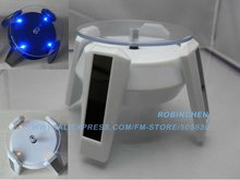 Dispaly for Cell Phone, Jewelry, toy, solar display, 4 led light, Turntable Rotary Display Stand, 360 degree rotate Freeshipping(China (Mainland))