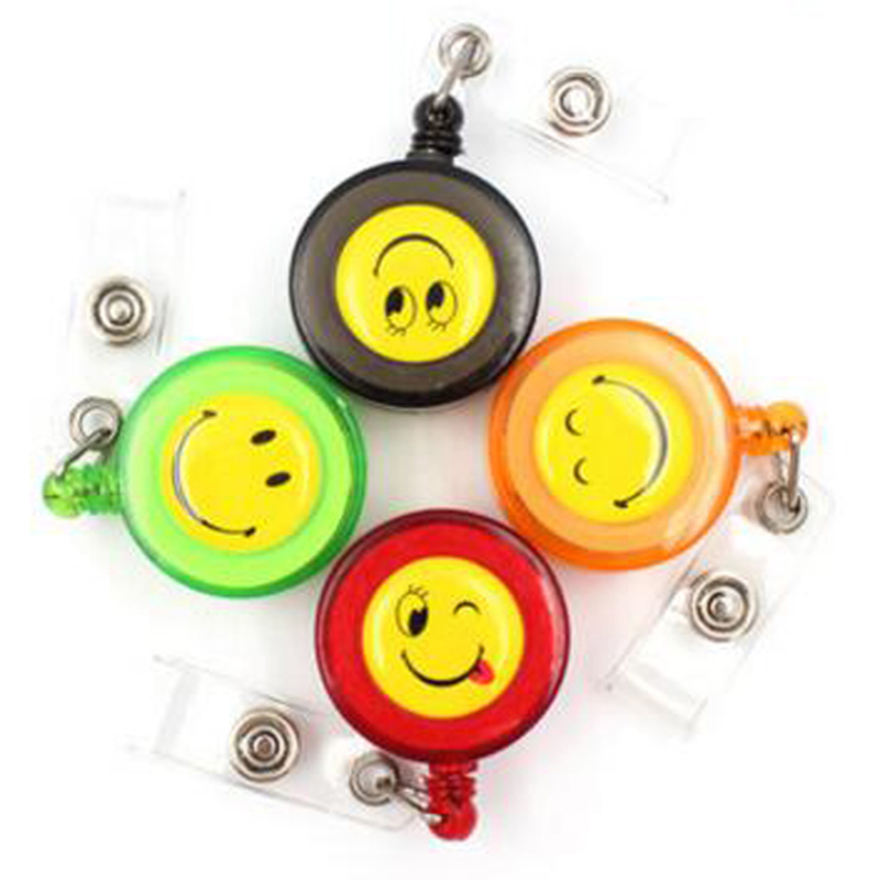 New 20pcs Smiling Face Retractable Lanyard ID Card Badge Holder Reels With Clip Keep ID Key and Cell phone Safe Free Shipping(China (Mainland))