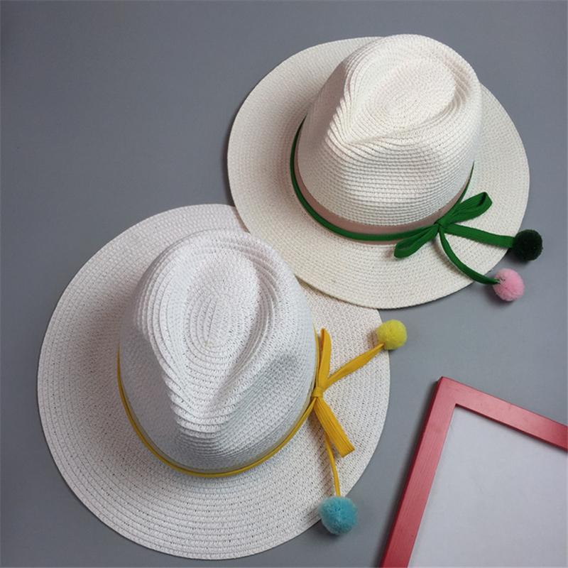 2016 new fashion snapback Panama hat female new fashion beach summer sun hat shading jazz straw hat hair ball(China (Mainland))
