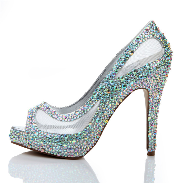 For the Crystal Peep-toe Trim we apply the crystals in a row along the edge of the peep toe. We offer many different color options. Each crystal is applied by hand to your shoe, for a truly one-of-a-kind look!