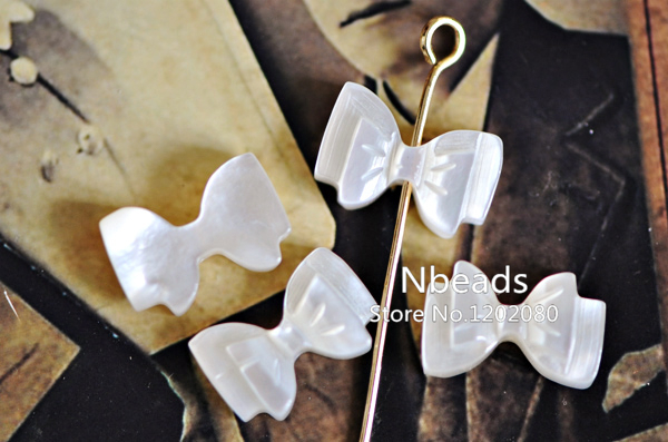 Buy white mother of pearl bow tie carved for Jewelry making supply store