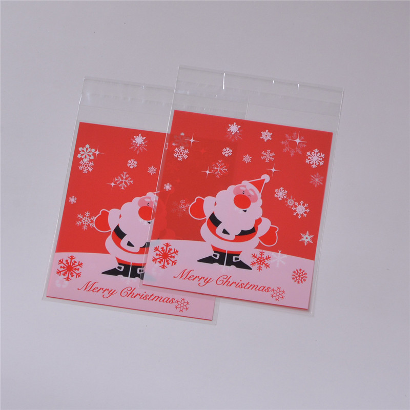10x11cm Christmas Party Decoration Red Santa Claus & Snowflakes Slef-adhesive Cute Small Cellophane Biscuit Cookie Bags(China (Mainland))