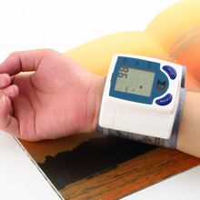 2015 New Health Care Home Automatic Wrist digital lcd blood pressure monitor portable Tonometer Meter for Measuring Pulse Rate(China (Mainland))