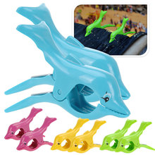 Buy Plastic Dolphin Designed Beach Towel Clips Large Sun Bed Lounger Holder for $2.48 in AliExpress store