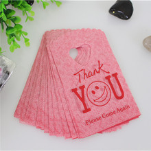 2015 Hot Sale New Style Wholesale 50pcs/lot 9*15cm Thank You Shopping Bags With Smile Mini Plastic Gift Bags(China (Mainland))