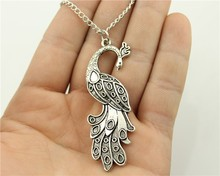 Buy WYSIWYG 2 colors antique silver, antique bronze color 61*21mm peacock pendant necklace,70cm chain long necklace for $1.28 in AliExpress store