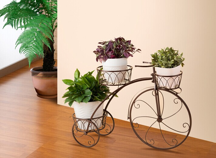 bicycle planter stands outdoors 3