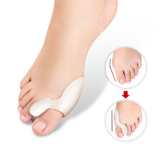 2pcs=1pair silicone finger protector hallux valgus pedi spin foot care detox foot patch care for a free shipping(China (Mainland))