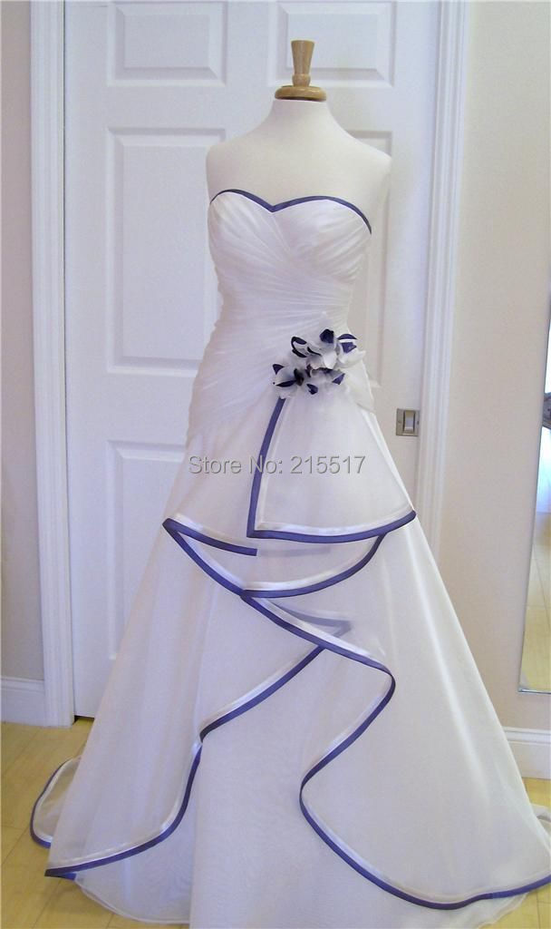 white w royal blue trim in wedding dresses from weddings