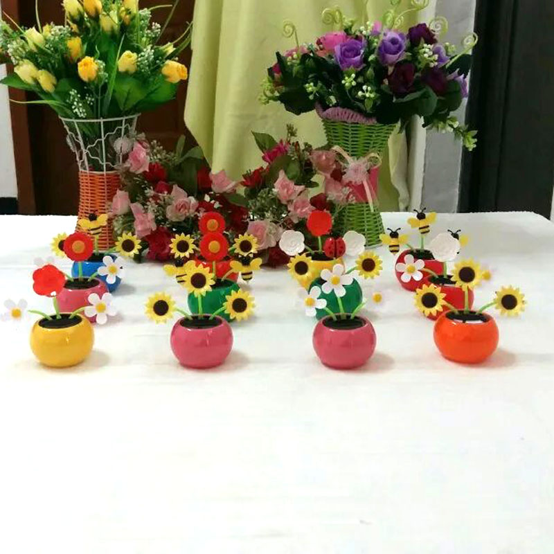 Wholesale Price 30 Pieces Per Lot Mix Colos And Styles Leaves Swing Under Full Light Novelty Toys Happy Dancing Solar Flowers(China (Mainland))