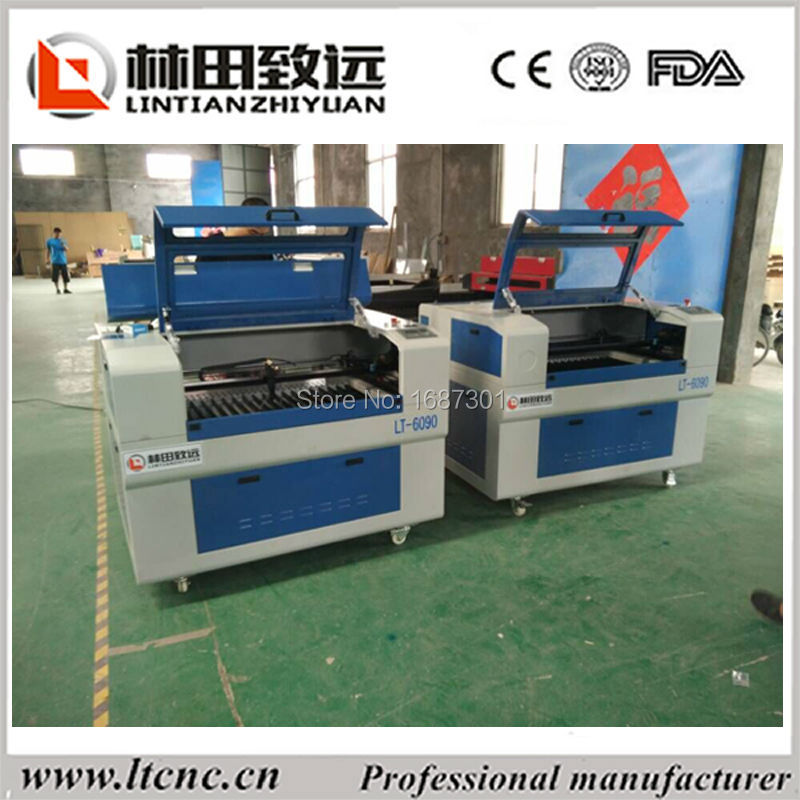 laser cut fabric flowers Affordable Laser Cutter co2 laser equipment(China (Mainland))