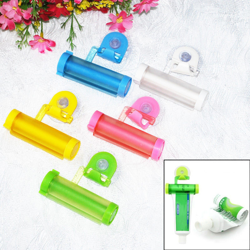 1 x HOT Easy Rolling Squeezer Toothpaste Sucker Hanger Holder Partner Dispenser Tube 5 Colors(China (Mainland))