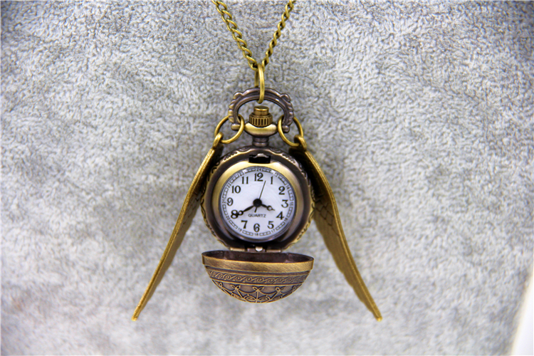 10pcs/lot Wholesale Fashion Jewelry Vintage Charm HP Snitch Wings Quartz Pocket Watch For Men And Women(China (Mainland))