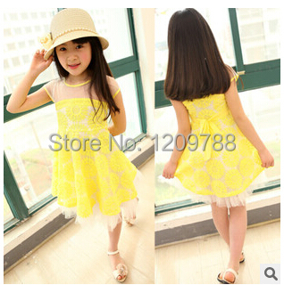 The new 2015 version of children's summer sun flower girl dress pleated lady lace yellow dress(China (Mainland))