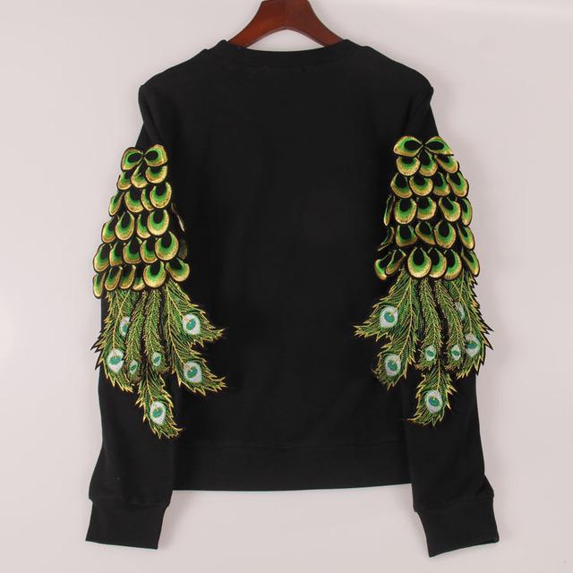 """Черный женский пуловер с аппликацией """"перья павлина"""""""