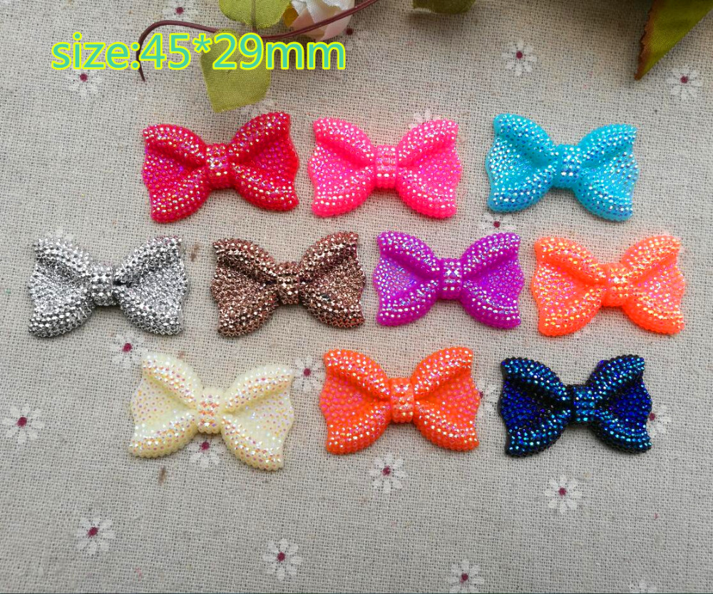 50Pieces resin tie mix color Flat back resin shining bows for DIY decoraction 45*29mm free fast shipping(China (Mainland))