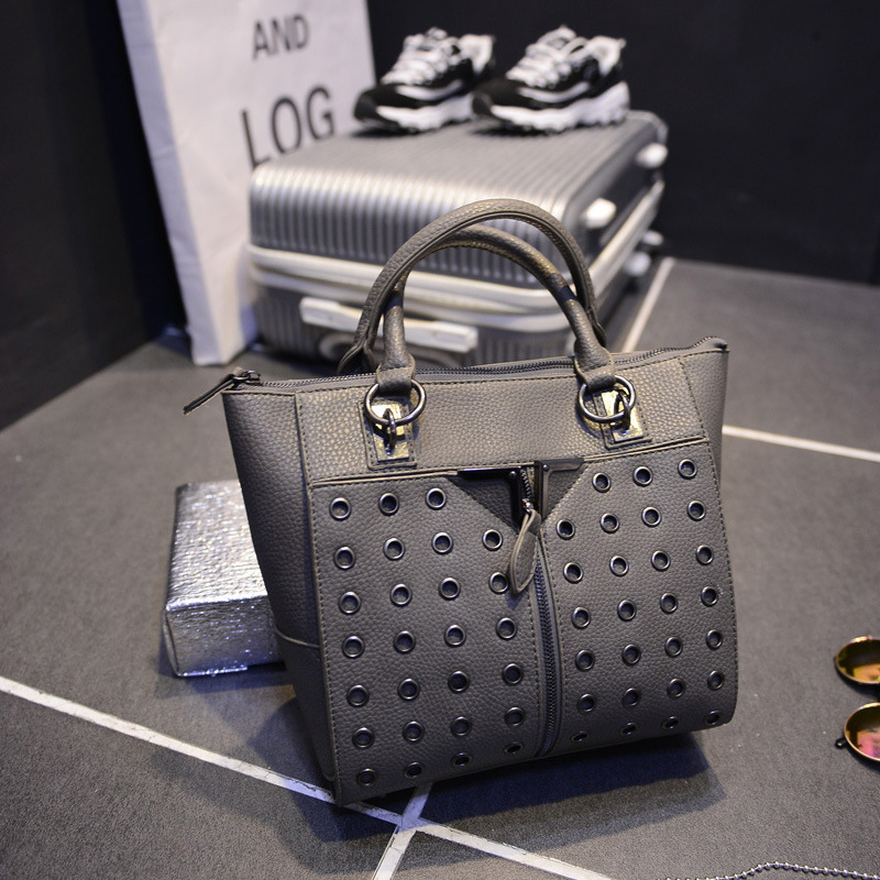 Фотография Winter 2015 new wave of female bag handbag European and American punk style ring Dongkuan rivets handbags hand diagonal package