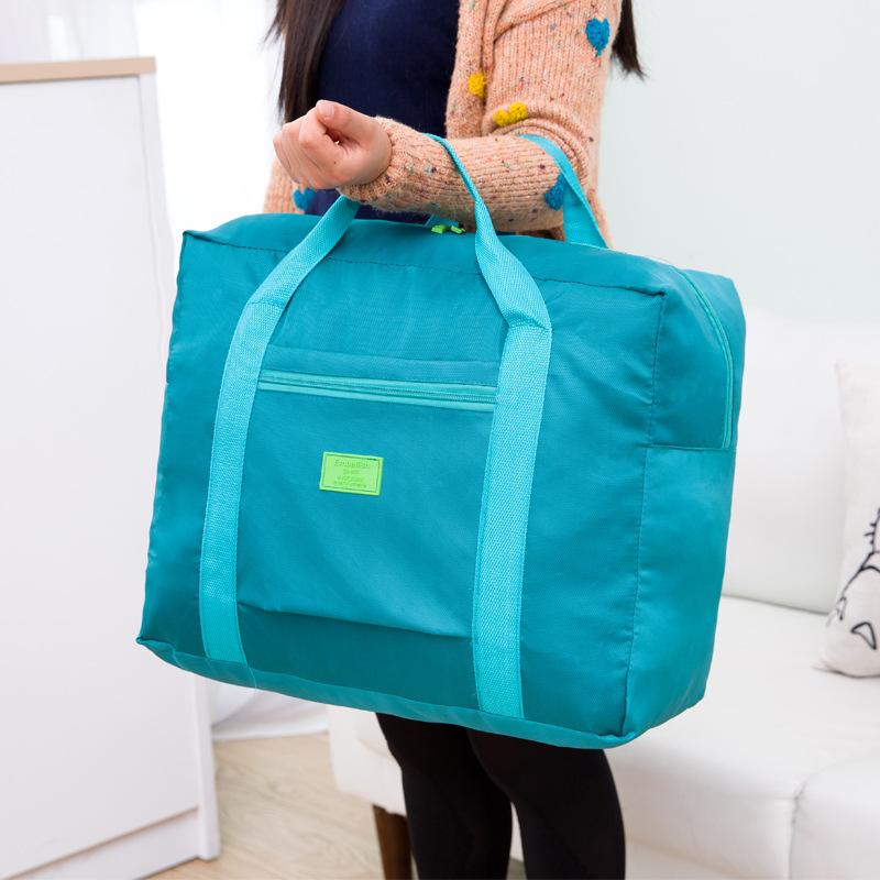 New Waterproof Unisex Travel Handbags Women Luggage folding Bags high-capacity portable travel bag(China (Mainland))