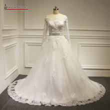 Luxury full pearls long sleeve wedding dress new model 2016(China (Mainland))