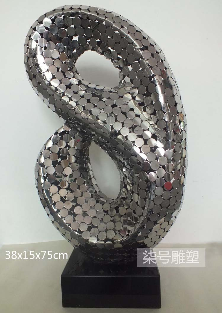 abstract metal sculpture of stainless steel discs decoration hotel