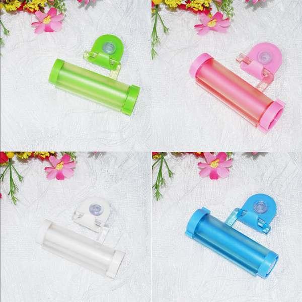 Гаджет  Free shipping Plastic Rolling Squeezer Toothpaste Dispenser Tube Partner Holder Sucker Hanging Worldwide None Мебель