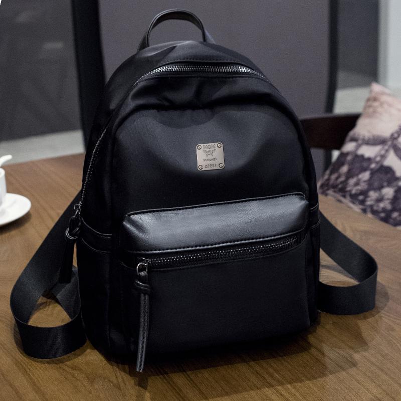 New Arrival Fashion Oxford Women Backpack Metal Logo Girls School Bag Tassel Zipper Women Bag(China (Mainland))