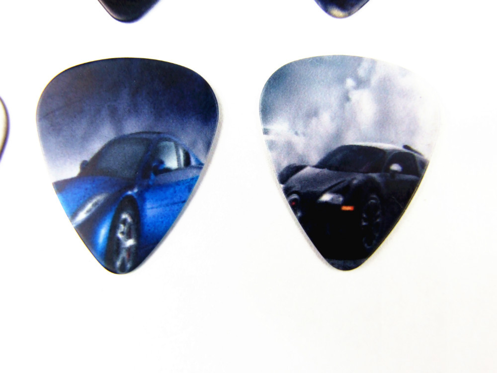 50PCS 0.71mm Hot sale exquisite high quality two side earrings pick DIY design car pick guitar picks(China (Mainland))