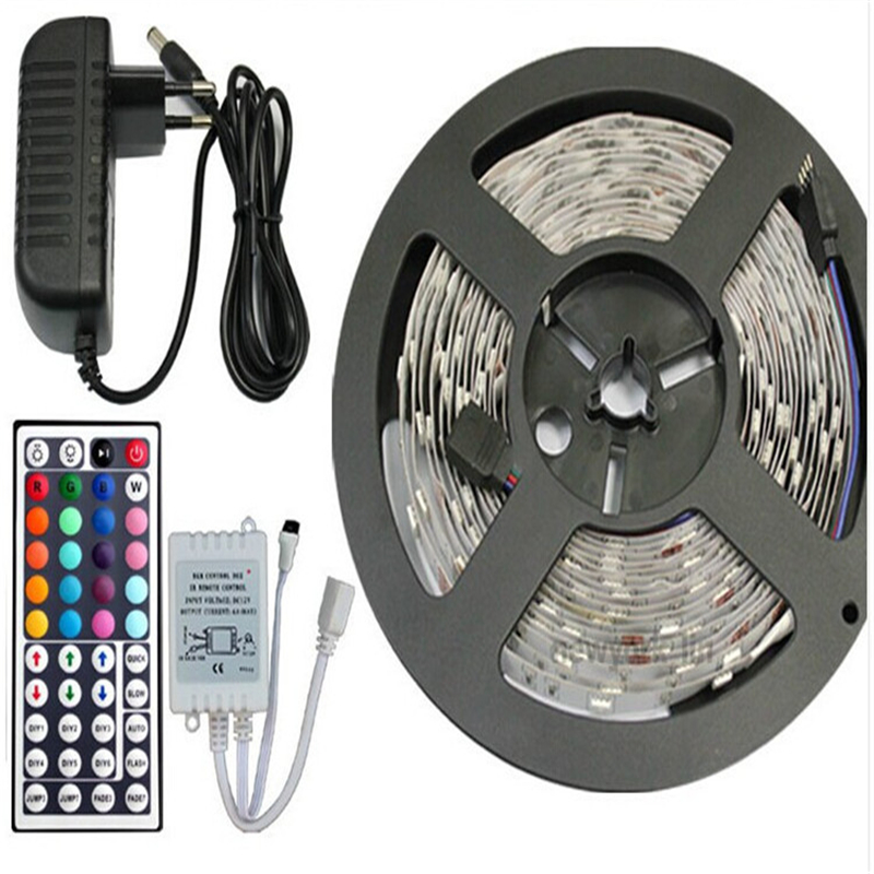 Freeshipping by Fedex 5sets of SMD3528 300LEDs/Roll+24 keys IR Remote+12V 2A Power Adapter RGB led strip light IP20 led tape(China (Mainland))