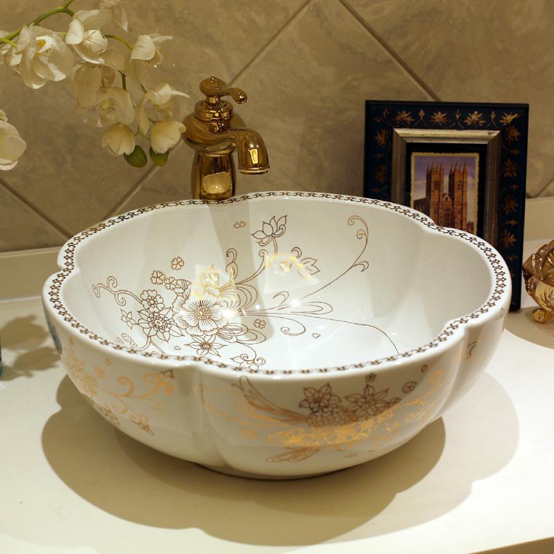 Гаджет  Ceramic counter basin wash basin wash basin art basin wash basin fashion petal None Строительство и Недвижимость